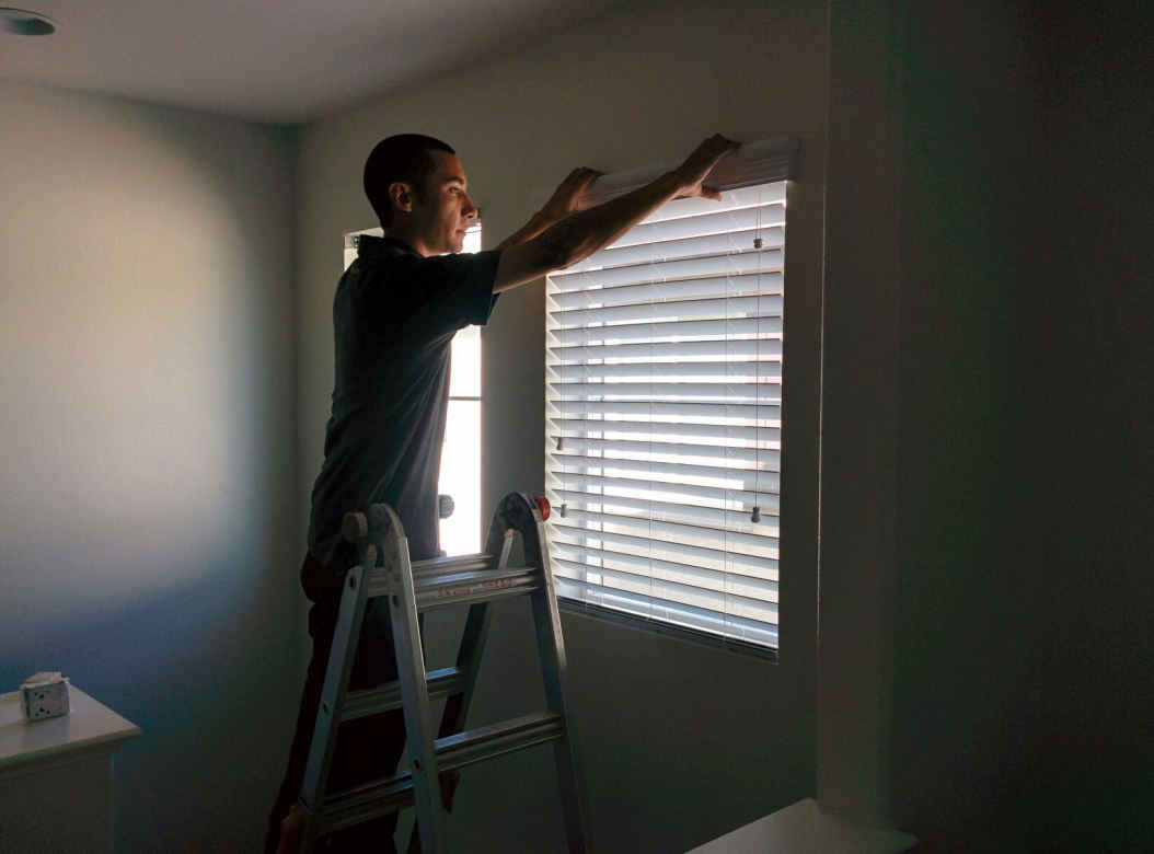 Jason installing blinds